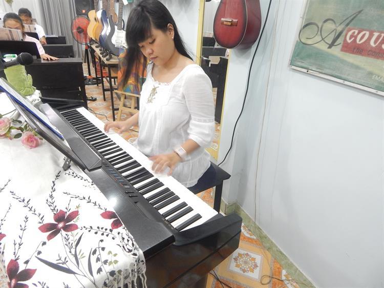 Học piano giỏi