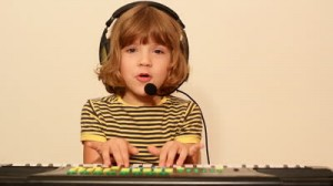 Stock-footage-little-girl-play-music-on-keyboard